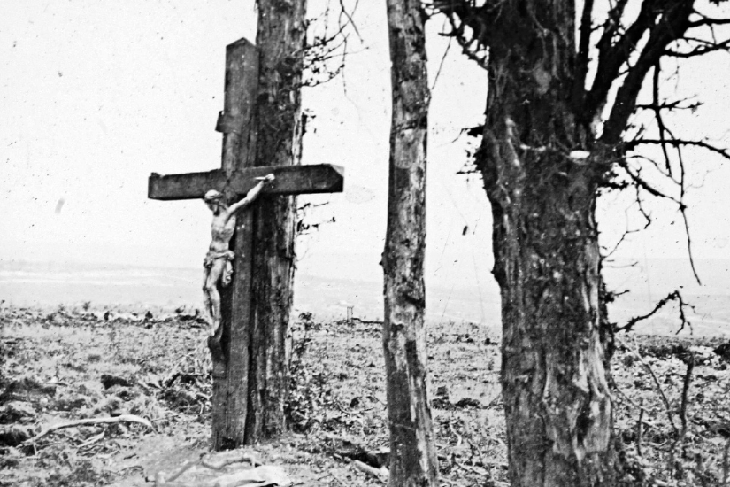 An archive picture shows a statue of Christ on the cross on a tree in Fricourt, France, during the First World War.
