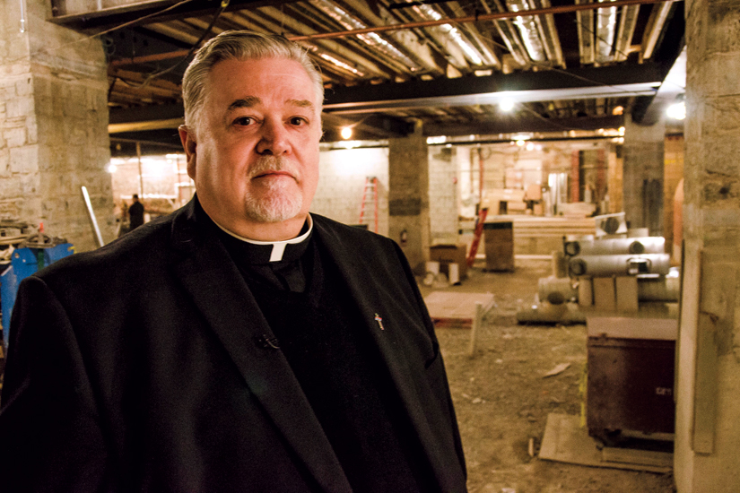 Fr. Michael Busch directed the renovation project. (Photo by Evan Boudreau)