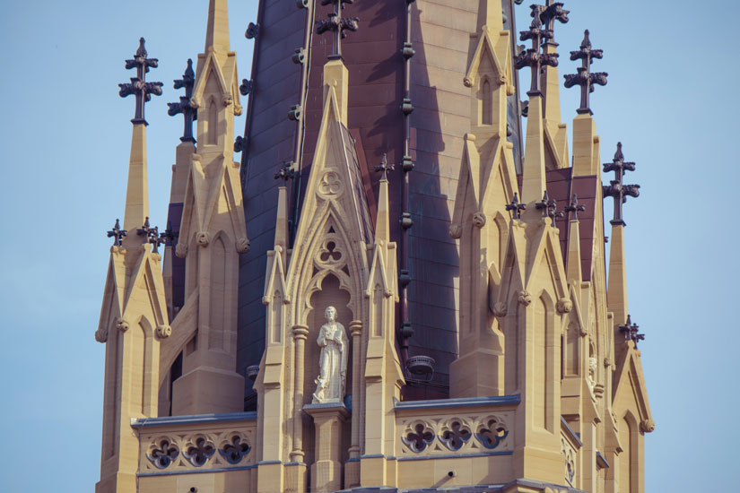 St. Michael's Cathedral's tower presented the biggest challenge to the exterior restoration project. Wherever possible, elements were conserved but most masonry had to be replaced with newly placed stones. (Photo by Michael Swan)