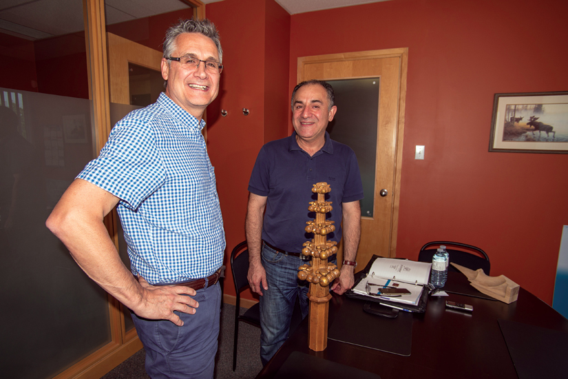 Vince Parolin, left, owner of Art Magic, and Abbas Ghassemi of Art for Everyday oversaw a team of woodworkers who restored the cathedral to its old world splendour. (Photo by Michael Swan)