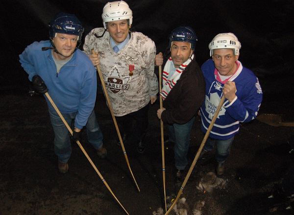 Showing they're just as photogenic as the students, St. Luke's gym teacher Andian Olsthoorn, trustee Frank D'Amico, TDCSB head office's Karmen Giambattist and Sam Dingillow, also from head office, strike a classic hockey stance before stepping on the ice for the ten shot challenge.