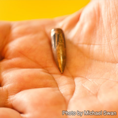 Wafi Shara shows the bullet she was struck with during an attack on a Baghdad church. (Photo by Michael Swan)