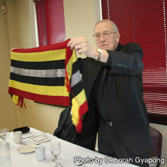 Gatineau Archbishop Roger Ebacher displays gifts from Sr. Clare Garcillano, a missionary in East Timor and a D&P partner.