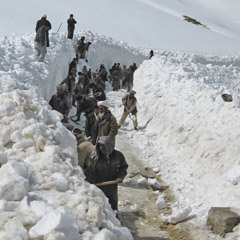 CRS enlists local Afghanis for a snow-clearing effort in Ghor through its cash-for-work program. (Photo courtesy of Scott Braunschweig)