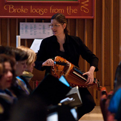 Trisha Postle plays the hurdy gurdy as she musically leads morning prayer from the Divine Office for the feast of St. Joseph, March 26 at Regis College. (Photo by Michael Swan)