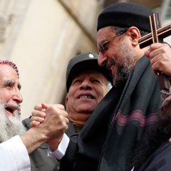A Christian cleric clasps hands with a Muslim sheik during a rally to demonstrate unity between Muslims and Christians in Tahrir Square in Cairo, Egypt, March 11. The rally took place after recent sectarian clashes left 13 people dead. (CNS photo/Mohamed Abd El-Ghany, Reuters)