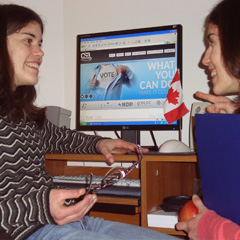 "Youth Speak News writers Annette Gagliano, left, and her sister Sarah, check out ""It's Your Vote,"" a web site which gives youth all the information they need to make an informed decision on May 2.  (Photo courtesy of Annette and Sarah Gagliano)"