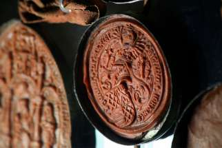 "Wax seals of members of the English House of Lords are seen March 1, 2012, on a letter from the Vatican Secret Archives. Citing the negative misinterpretations that the word ""secret"" implies, Pope Francis has changed the name of the archives to the Vatican Apostolic Archives."