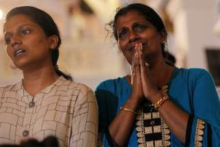 Family members of victims react while praying during the reopening ceremony of St. Anthony's Shrine in Colombo, Sri Lanka, June 12, 2019, months after it was closed because of an Easter bombing. A top British official said the government would commit itself to a robust defense of persecuted Christians following a new report into their plight.