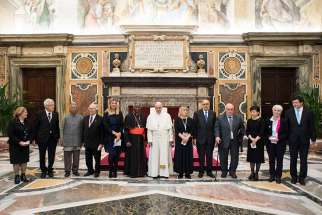 Pope Francis poses with Nobel Peace Prize laureates during an audience with attendees at a conference on building a world free of nuclear weapons, at the Vatican Nov. 10. Also pictured is Cardinal Peter Turkson, prefect of the Vatican's Dicastery for Promoting Integral Human Development.