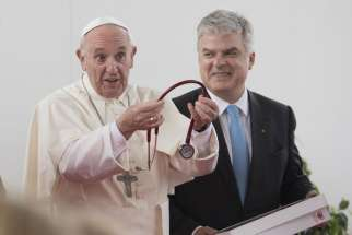 Pope Francis receives a stethoscope from the President of the European Society of Cardiology, Fausto Pinto, as he attends the World Congress of the European Society of Cardiology Aug. 31 in Rome.