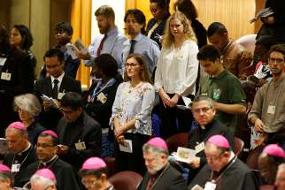 Bishops and observers attend a session of the Synod of Bishops on young people, the faith and vocational discernment at the Vatican Oct. 18.