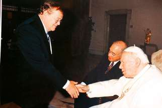 Senate Speaker Noel Kinsella, when he was Leader of the Opposition in the Senate, greets Pope John Paul II at a meeting in the Vatican in 2002.