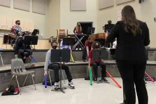 "Kait Tappenden conducts St. Mary's College music students, including the ""Boomwhackers."""