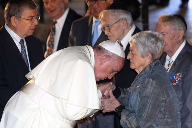 Pope Francis kisses the hand of a woman during a ceremony in the Hall of Remembrance at the Yad Vashem Holocaust memorial in Jerusalem May 26.