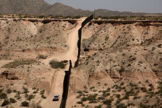 A Border Patrol vehicle is seen close to the current border fence in Sunland Park, N.M., in this photo taken April 4 from Ciudad Juarez, Mexico.