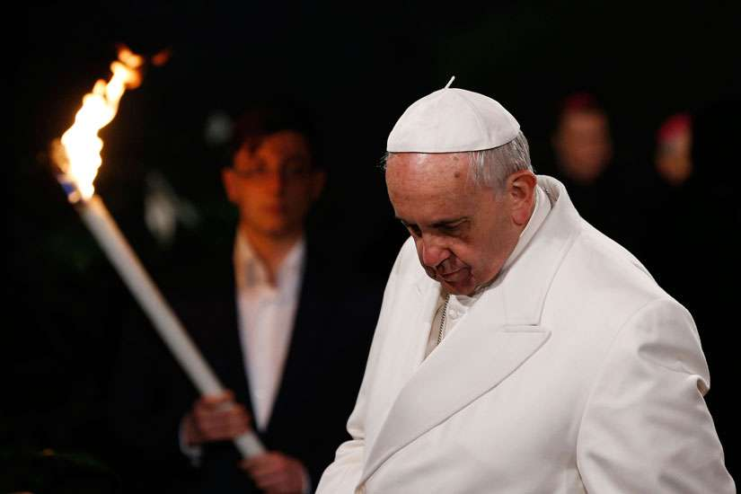 Pope Francis presides at the Way of the Cross outside the Colosseum in Rome April 3.