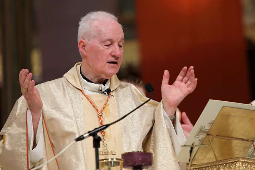 Cardinal Marc Ouellet, prefect of the Congregation for Bishops, and Cardinal Gerald Lacroix of Quebec City, concelebrate Mass July 26 at the Basilica of Ste.-Anne-de-Beaupre in Ste.-Anne-de-Beaupre, Quebec, on the feast of St. Anne.