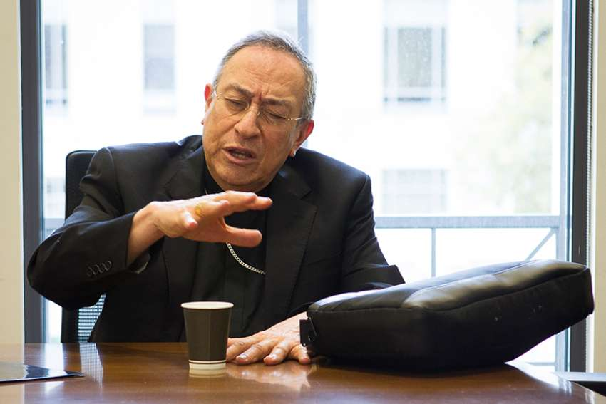 Cardinal Oscar Rodriguez Maradiaga of Tegucigalpa, Honduras, speaks to reporters at the Edward Bennett Williams Law Library at the Georgetown University Law Center in Washington Nov. 2.