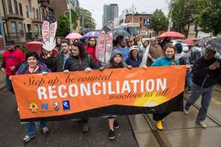 Native and non-native Canadians walked from Parliament and Dundas Streets to Queen's Park to mark the close of the five-year inquiry of the Truth and Reconciliation Commission of Canada May 31.