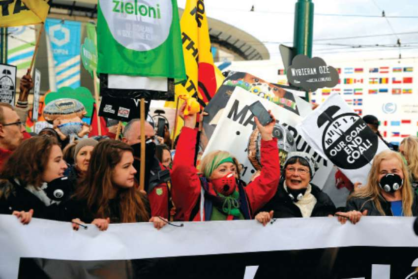 Protesters march outside the venue of the UN climate change conference in Katowice, Poland.