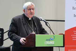 "Cardinal Thomas Collins, in a session called ""Welcome the Stranger,"" speaks at the Parliament of the World's Religions in Toronto Nov. 6."