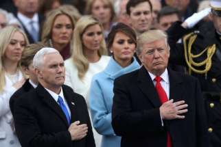 U.S Vice President Mike Pence and President Donald Trump stand for the singing of the national anthem after Trump's swearing-in as the country's 45th president at the U.S. Capitol in Washington.
