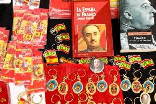 Souvenirs are displayed at a 2019 demonstration in Madrid against the exhumation of Spain's former dictator, Gen. Francisco Franco. The Vatican released a statement July 21, 2020, distancing itself from any involvement in the Spanish government's decision to exhume Franco's remains, a divisive issue in that country.