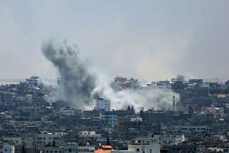 Smoke rises from Gaza City after an Israeli airstrike July 29. Violence escalated the previous night after an attempted unofficial truce for the three-day Eid al-Fitr holiday crumbled.