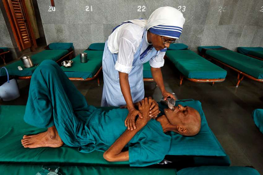 A member of the Missionaries of Charity tends to a patient in 2016 in Kolkata, India. Indian officials are seeking to freeze bank accounts of the Missionaries of Charity following the July 5 arrest of a nun on child trafficking charges.