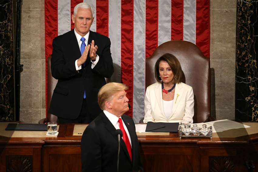 U.S. Vice President Mike Pence applauds and House Speaker Nancy Pelosi, D-Calif., looks on as President Donald Trump delivers his second State of the Union address Feb. 5, 2019, at the Capitol in Washington. During his speech Trump urged Congress to pass legislation that bans late-term abortion.