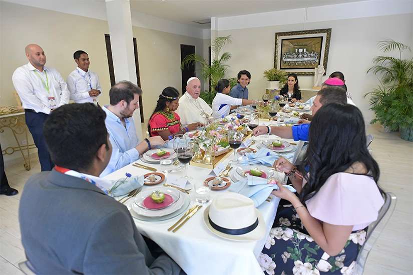 Pope Francis has lunch with a group of World Youth Day pilgrims at the San Jose seminary in Panama City Jan. 26, 2019.