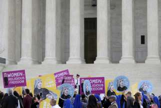 Women religious and others demonstrate against the Affordable Care Act's contraceptive mandate March 23 near the steps of the U.S. Supreme Court in Washington. The court heard oral arguments inthe Zubik v. Burwell mandate case.