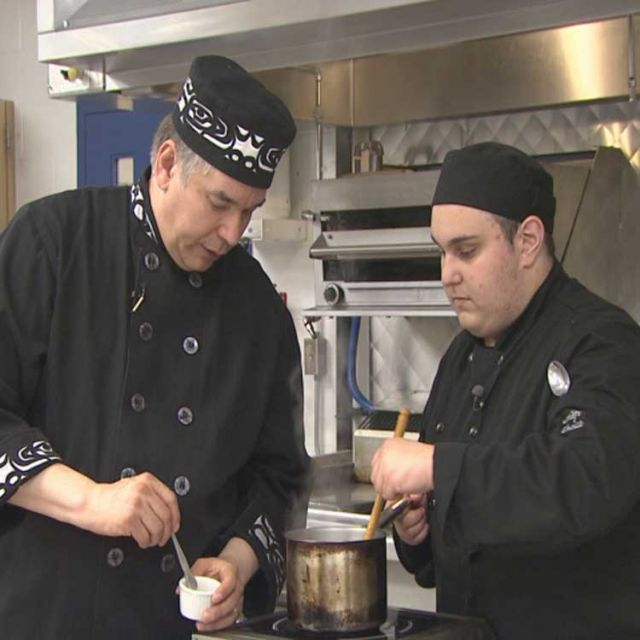 Jacob Dias works with guest chef David Wolfman.