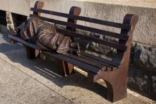 """Homeless Jesus"" is pictured in this July 29 photo of the seven-foot-long bronze sculpture that sits in front of a downtown Washington building occupied by Catholic Charities of the Archdiocese of Washington. Pope Francis is expected to pass by the statue Sept. 24 during the Washington-leg of his U.S. visit."