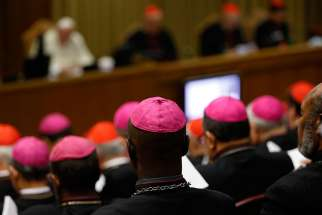 Bishops and cardinals attend the morning session of the extraordinary Synod of Bishops on the family at the Vatican Oct. 13.