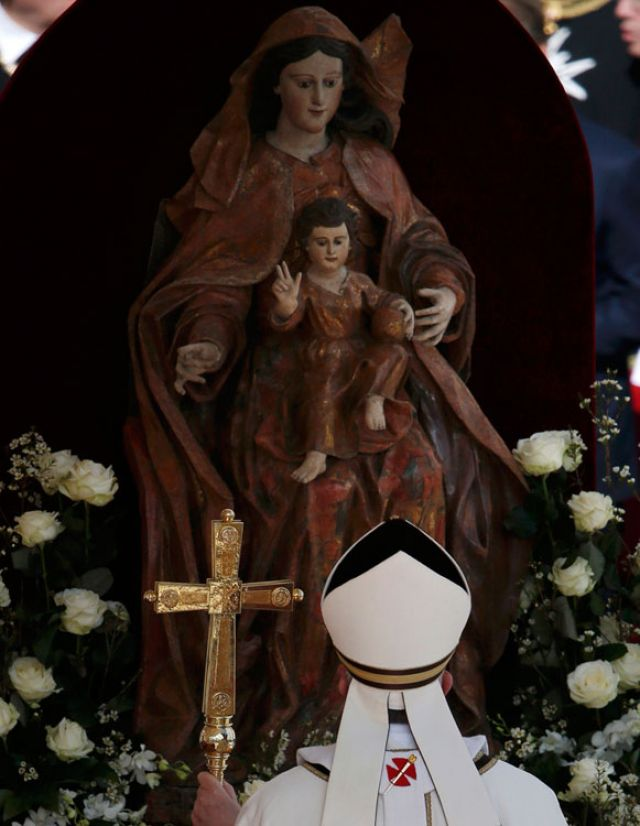 Pope Francis pauses in front of a statue of Mary and Jesus as he arrives to celebrate his inaugural Mass in St. Peter's Square at the Vatican March 19.