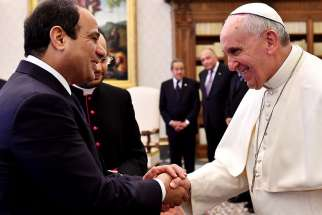 Pope Francis and Egypt's President Abdel Fattah al-Sisi shake hands during a private audience in 2014 at the Vatican. Accepting an invitation from Egypt's president and top religious leaders, Pope Francis will visit Cairo April 28-29.