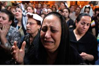 A Coptic Christian woman cries during a prayer service at a church in Cairo May 8.