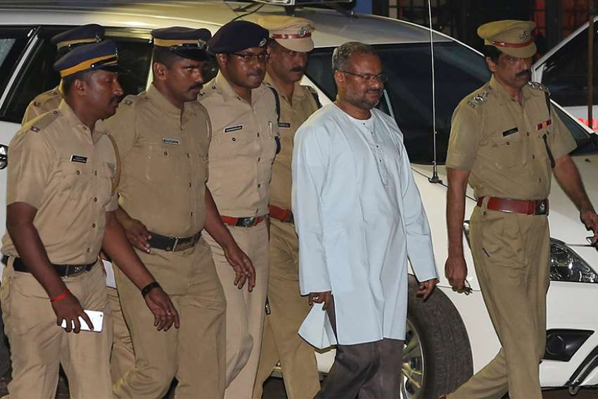 Bishop Franco Mulakkal of Jalandhar, India, is led away for questioning by police on the outskirts of Cochin Sept. 21, 2018. Indian police have charged Bishop Mulakkal of repeatedly raping a nun in her rural convent, the Associated Press reported April 9, 2019.