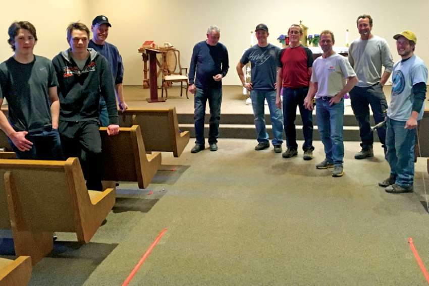 Parishioners at St. Emerence installed new pews as part of extensive renovations of their church in Rivière Qui Barre, northwest of Edmonton.