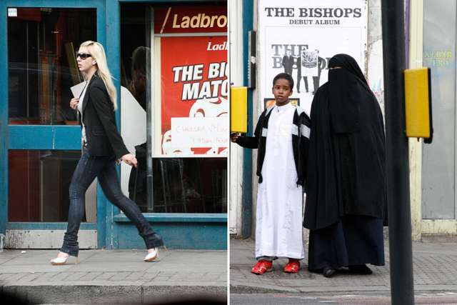 Right: a woman wearing a niqab stands by a light crossing with a boy. Left: a woman wearing sunglasses walks past a store.