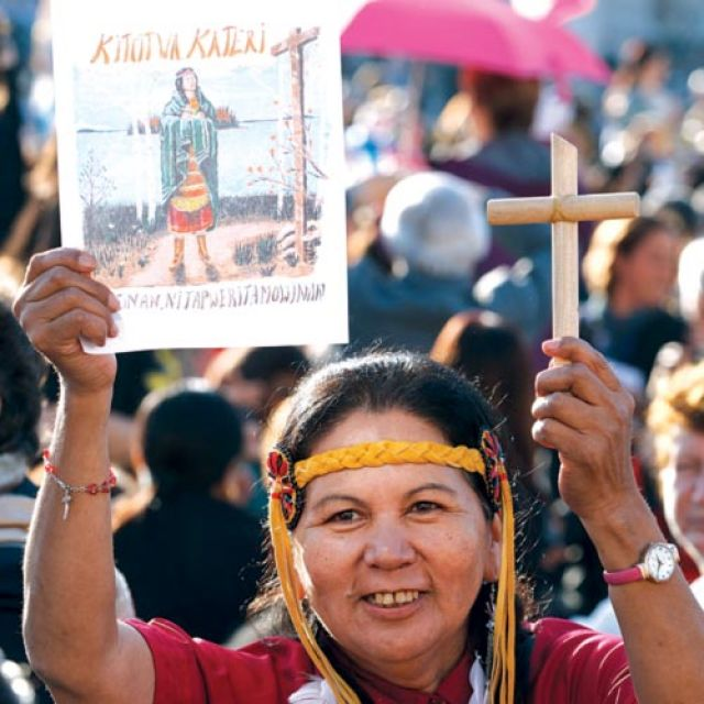 A native American woman holds up an image of St. Kateri Tekakwitha before the canonization Mass for seven new saints led by Pope Benedict XVI in St. Peter's Square at the Vatican Oct. 21.