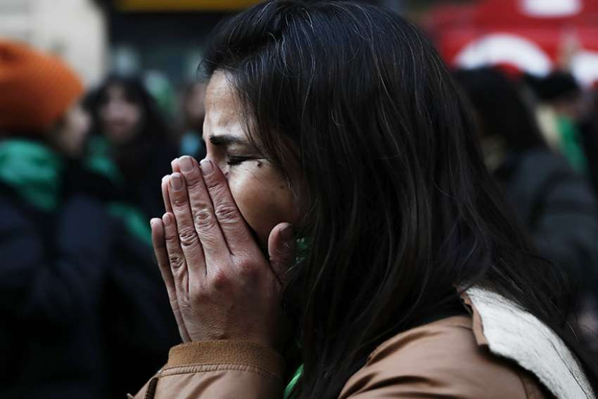 A woman in Buenos Aires, Argentina, reacts June 14 after hearing that the nation's lower house approved a bill to legalize abortion in the first 14 weeks of pregnancy.