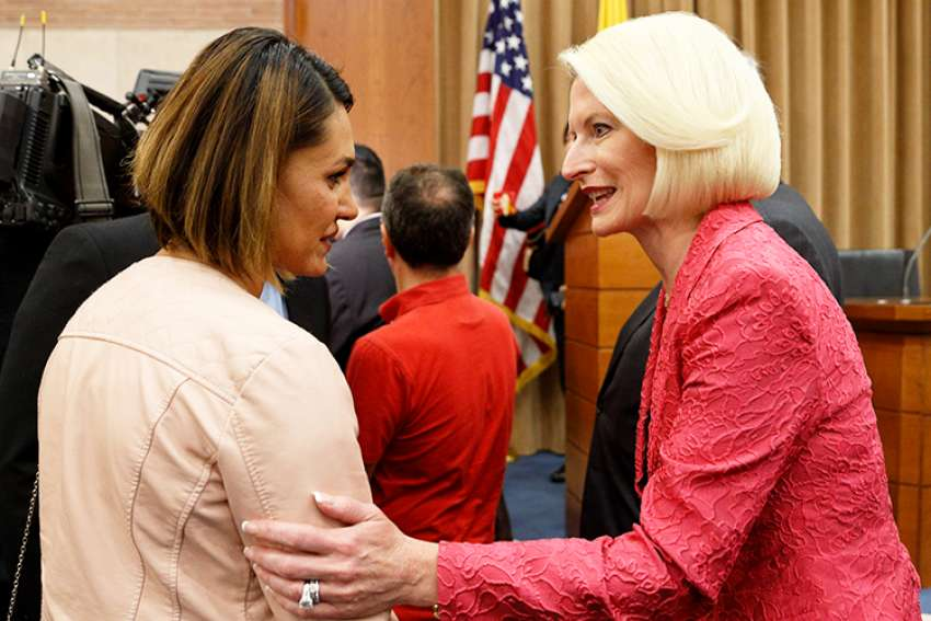 Salwa Khalaf Rasho, a human rights activist who escaped Islamic State captivity, talks with Callista Gingrich, U.S. ambassador to the Vatican, during a symposium on religious freedom presented by the U.S. Embassy to the Holy See in Rome June 25.