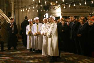 Pope Benedict XVI stands next to Emrullah Hatipoglu, imam of the Blue Mosque, and Mustafa Cagrici, right, the grand mufti of Istanbul, as he visits the Blue Mosque in Istanbul in this Nov. 30, 2006, file photo. The pope's unexpected prayer next to the mu fti in the mosque soothed anger in the Muslim world over a quote about Islam in his Sept. 12, 2006, lecture in Regensburg, Germany. It was only the second time a pontiff had entered a mosque.