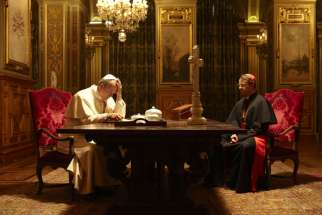 Aurélien Recoing as Pope John Paul II and Laurent Lucas as Cardinal Aaron Jean-Marie Lustiger in The Jewish Cardinal.