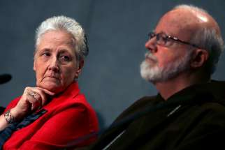 Irish abuse victim Marie Collins, the lone clerical abuse survivor nominated by Pope Francis to sit on the new Pontifical Commission for the Protection of Minors, looks at Boston Cardinal Sean P. O'Malley during their first briefing at the Holy See press office at the Vatican May 3.