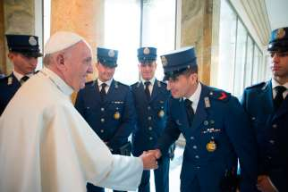 Pope Francis greets Vatican police officers after celebrating a Mass for them at the Vatican in 2015. The Pope celebrated Mass on the 200th anniversary of the Corps of the Vatican Gendarmes, Sept. 18.