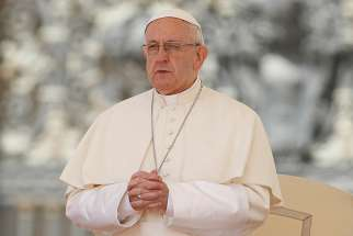 Pope Francis prays as he leads his general audience in St. Peter's Square at the Vatican May 16.